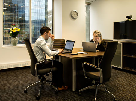 one on one meeting in an executive office