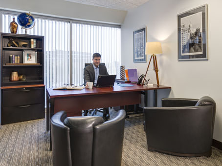 nice executive office with brown leather sofa