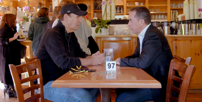 Super Dave and Seinfeld at coffee shop meeting