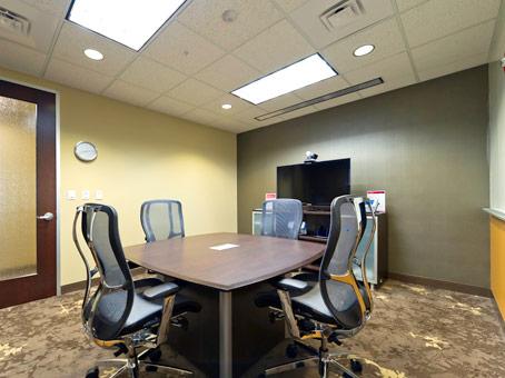 desks with LED flatscreen TV with wooden door