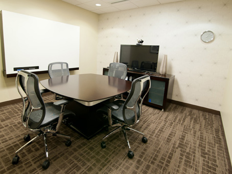 white board with chairs and desks