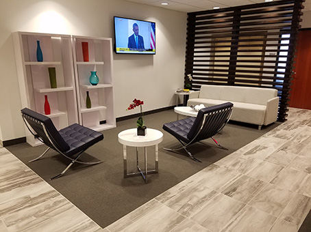 white sofa and LED television