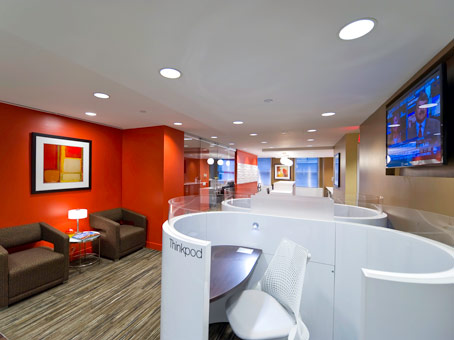 orange wall with painting and white cubicle