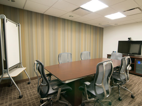 long table with a white bulletin board