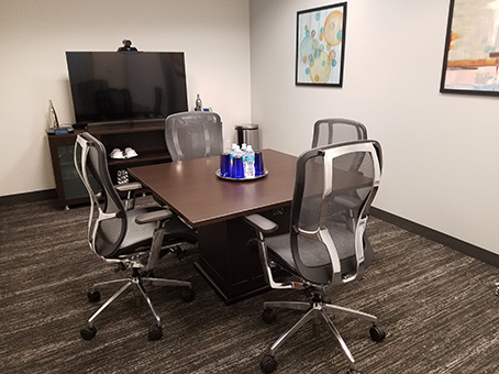 small meeting room table and LED TV