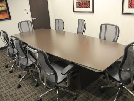 long wooden table in a meeting room