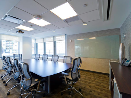 long wooden table in a large meeting room
