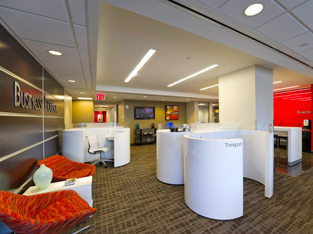 a number of white cubicle in the lobby