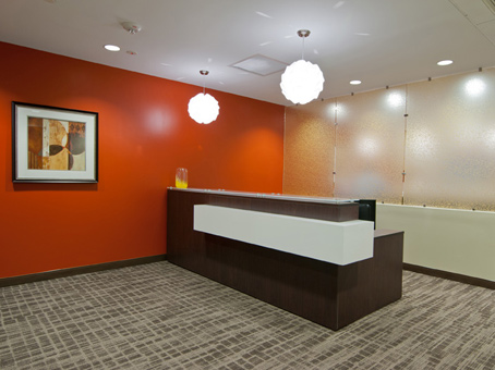 orange wall, brown and white reception table