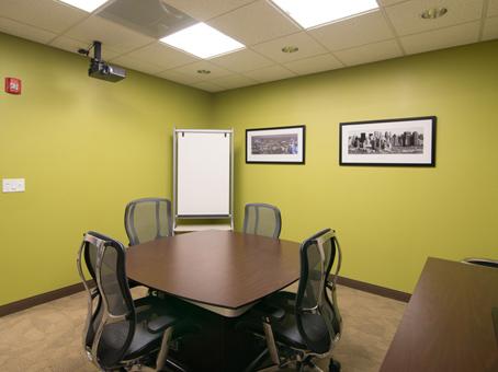 white board and brown desks