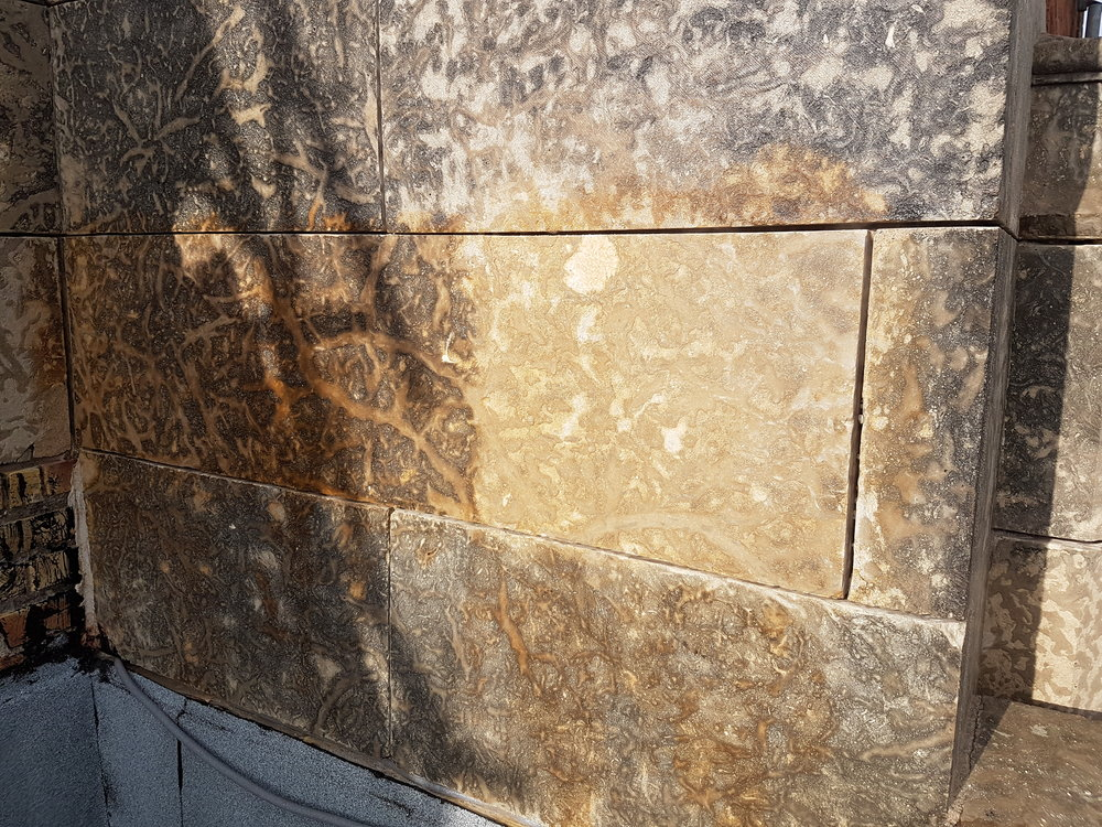 Cleaner on Limestone carbon deposits.jpg