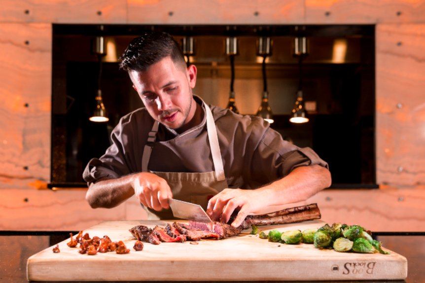 Chef Jean Delgado Shaving fresh meat at Toro Toro Miami