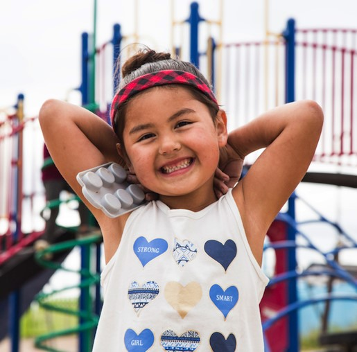 Little girl with jungle gym behind - newsletter 1 blog 1.jpg
