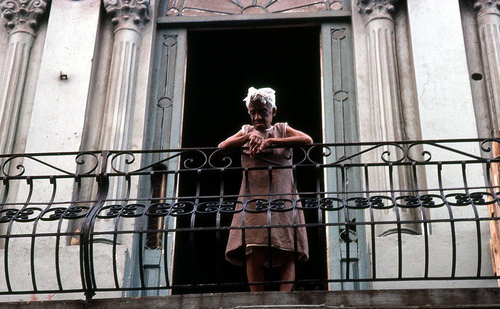 Cuban woman on balcony