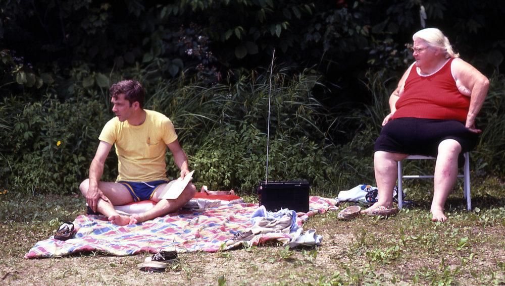man and woman near beach