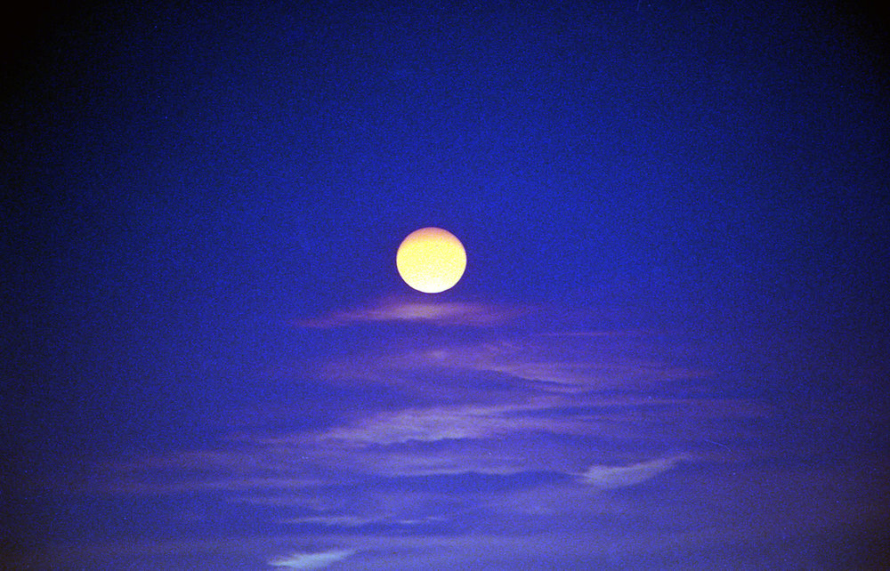 Moon in purple sky
