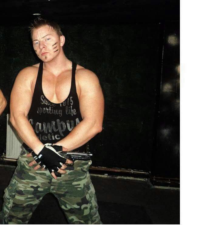 Example of a bad male strip costume - the top isn't even part of the camo uniform.