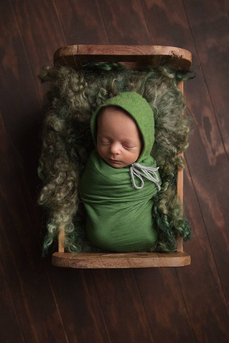 Tania Fernandes newborn baby boy geelong photo green wrapped bed.jpg