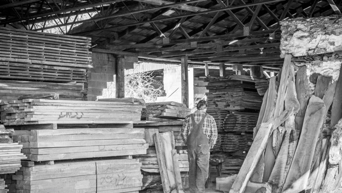 Keith looking for boards in one of his lumber sheds in Jefferson, Maryland