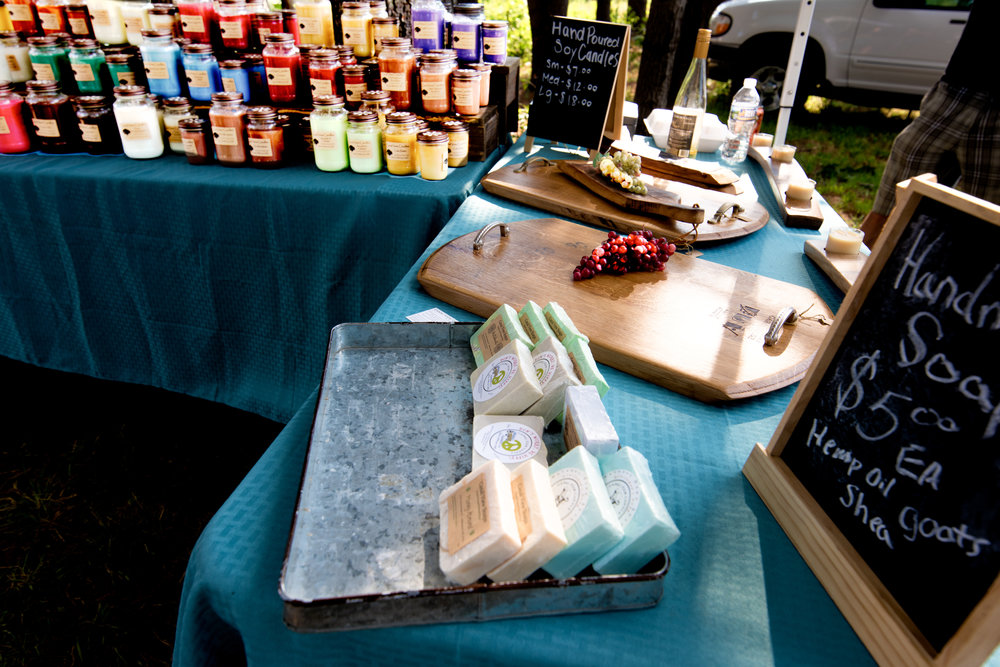 Handmade soaps, candles, and cheeses  photograph by John Canan