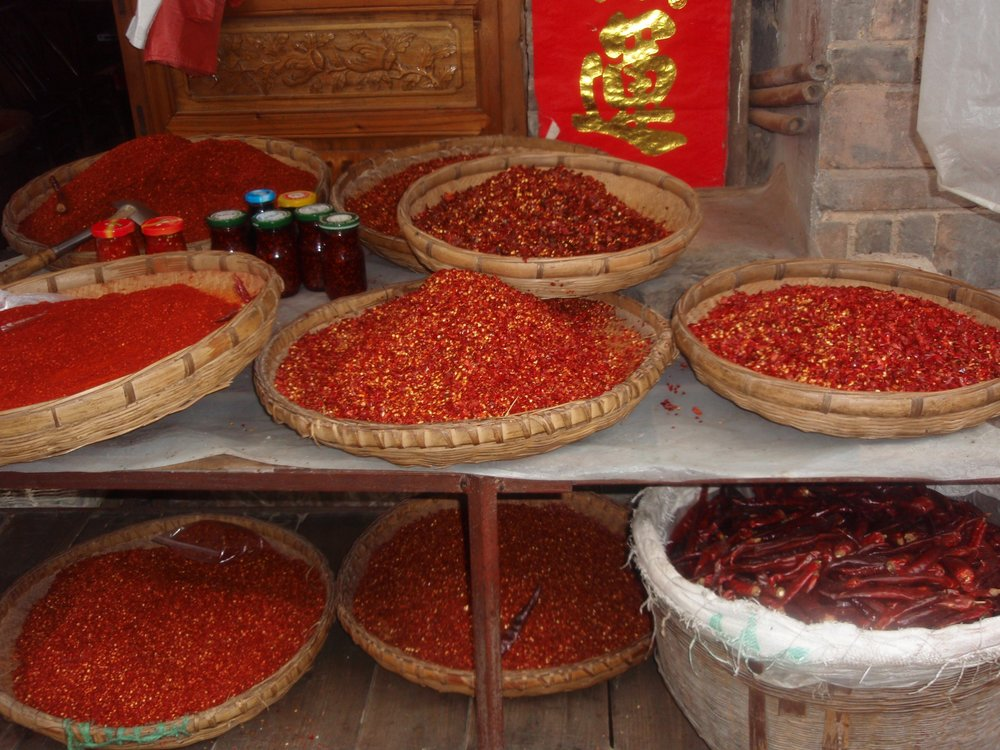 Jishou, Hunan: Dried chilies for sale in the morning market, Summer 2009