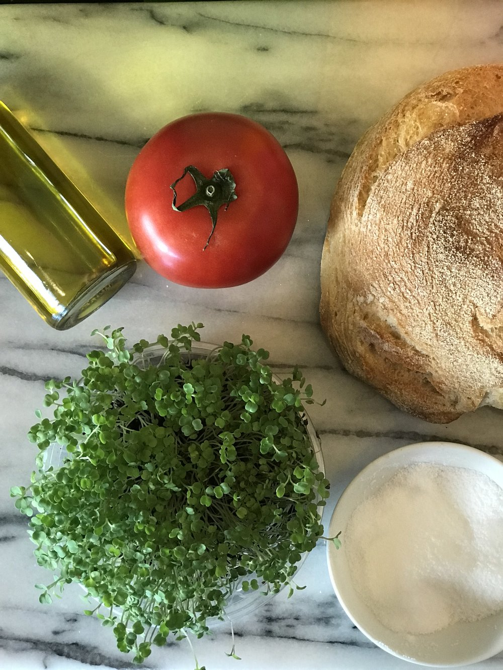 Extra Virgin Olive Oil, Tomato, Ciabatta, Living Arugula Microgreens, Salt. Not pictured, fresh whole milk mozzarella.