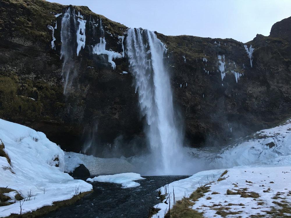 Iceland-WalkBehindWaterfall.jpg