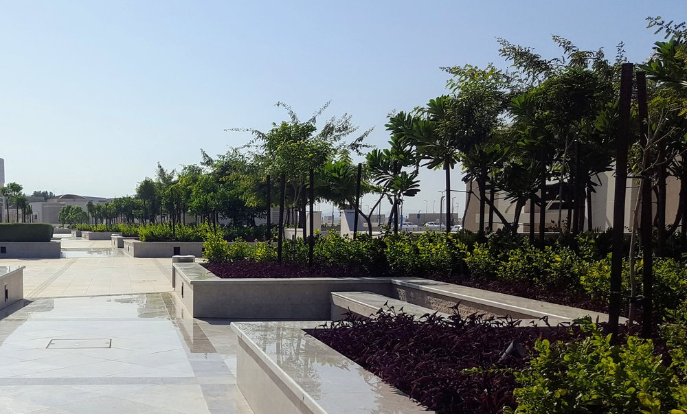 Informal and formal: generous planting round the seating nooks reflects in polished marble