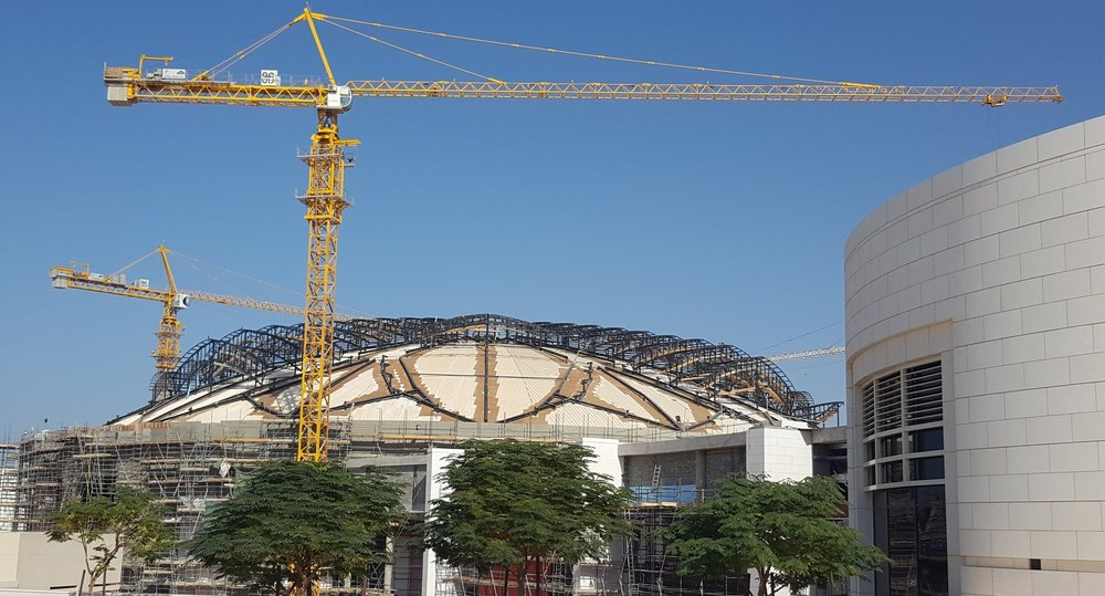 The roof of the exhibition centre is going up.
