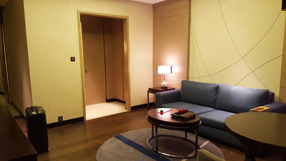 Hormuz Grand Room seating area to bathroom door.jpg