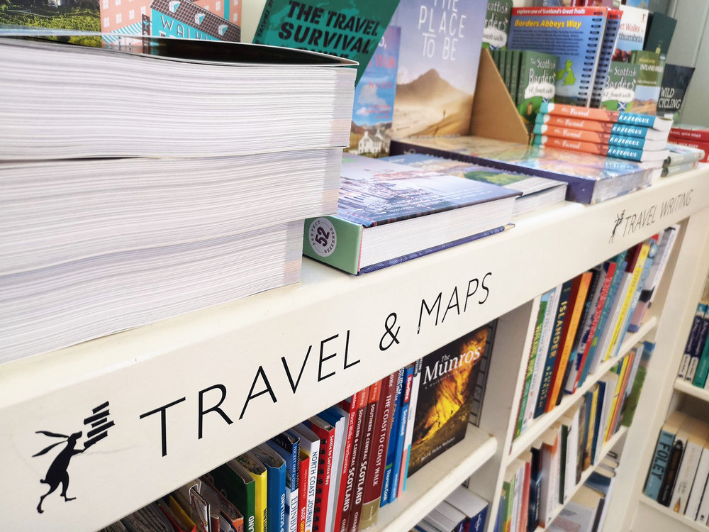Shelving labels feature The Mainstreet Company's logo, the book-balancing hare