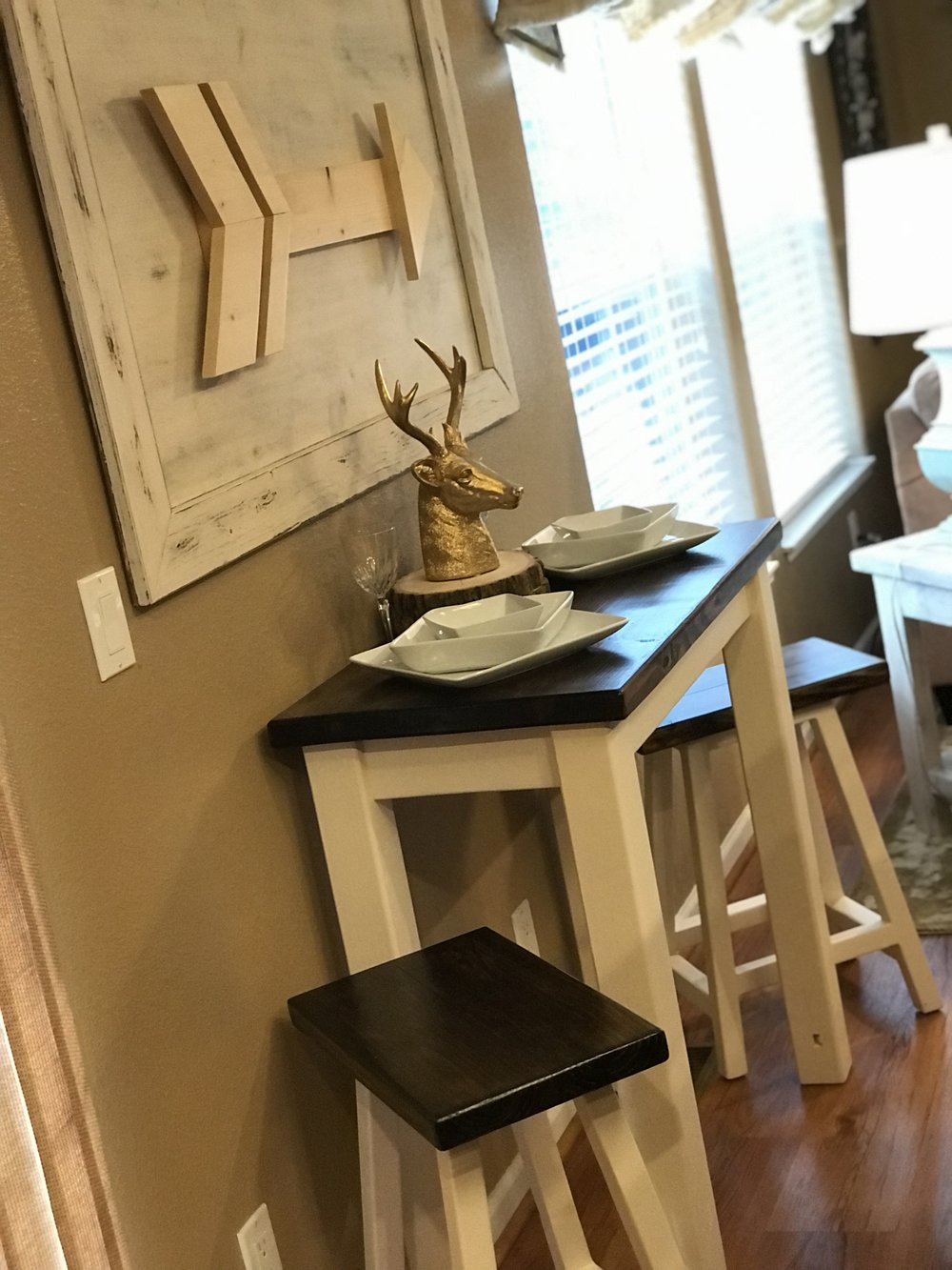 Bistro Table with Stools and Arrow Wall Art