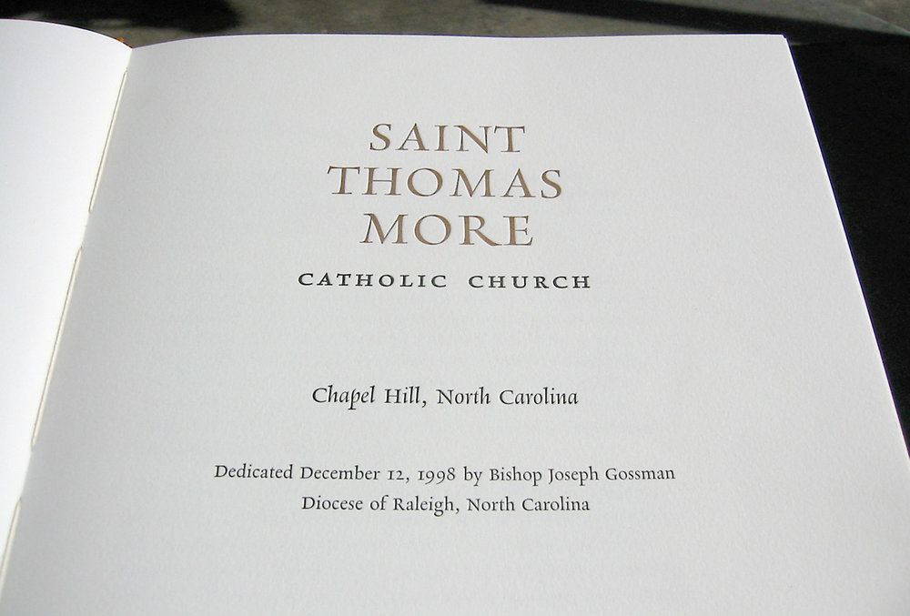 Title page of hand-printed, hand-bound book for the chuch entryway. A deluxe book was created to thank donors and provide a brief history of the church instead of doing a wall memorial.