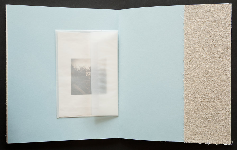 Each hand-sewn book includes a print suitable for framing inside a translucent envelop adhered to the inside back cover.