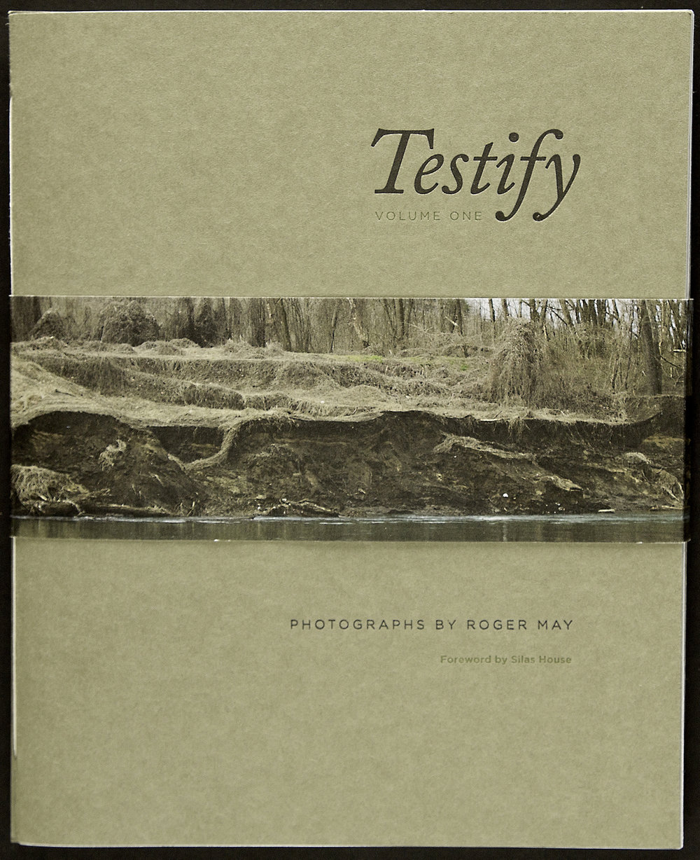 A printed bellyband holds the two volumes of this poetry collection together. The image is of the Tug River which separates West Virginia from Kentucky, the two states where Roger made the photographs in this collection.