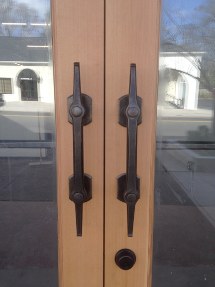 Hand-forged door pulls by Ben Galata with pierced joinery. Ben also has sculptures and birdbaths in the gallery.