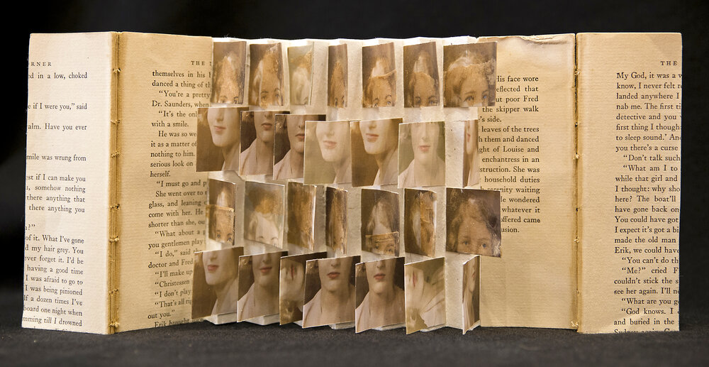Dawn Surratt. Dawn's work weaves together connections between loss, healing, and spirituality through images, books, and photography-based-installations. She will be part of a two person show (with Lori Vrba) during September and October.