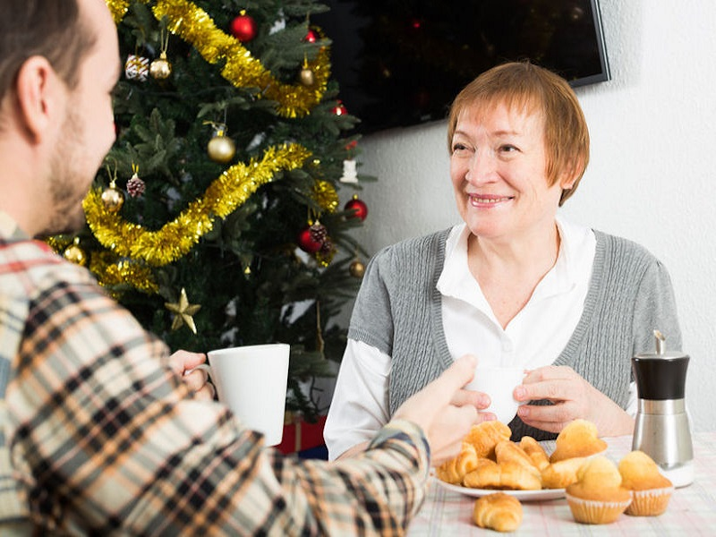 5 Ways to Celebrate the Holidays with a Family Member Who Has Dementia   Celebrating the holidays with a family member who has dementia can be bittersweet. Adult children who have a loved one with dementia often have a harder time adjusting to the joys of the season, especially because that loved one may have been an integral part of family traditions.  Despite the emotional toll the holidays may take, the winter season should be a time to reflect on blessings and good fortune. Here are some ideas for making sure the holidays run smoothly for you and your family member living with dementia.   1. Plan in advance. Every family celebrates the holidays differently. Spending quality time with a loved one living in a senior living community can be highly rewarding. Family members are welcome to join their loved ones for special holiday functions, live entertainment or social gatherings. If your loved one's community is long-distance, consider sending flowers or even arranging for the staff to help set up a video chat through FaceTime or Google Hangouts.   2. Give thoughtful gifts. Put together a photo album with names and dates and read through it with your loved one. While they may have difficulties recalling some of the moments, each image can help to stimulate their most cherished memories. Or, give them a CD with some of their favorite songs from the 30s and 40s. According to the  Alzheimer's Association , seniors can often remember and sing songs even in advanced stages of dementia. If your family has young kids, consider asking them to draw a picture or make a card. The grandkids will be just as excited to give a gift as your loved one will be to receive it.   3. Schedule times for your loved one to rest. If you can bring your loved one to your home, ensure they won't miss any important traditions by planning their resting times around holiday meals and activities. Aging takes a toll on the body and lowers energy levels, so it's common for seniors to need a rest. Tr