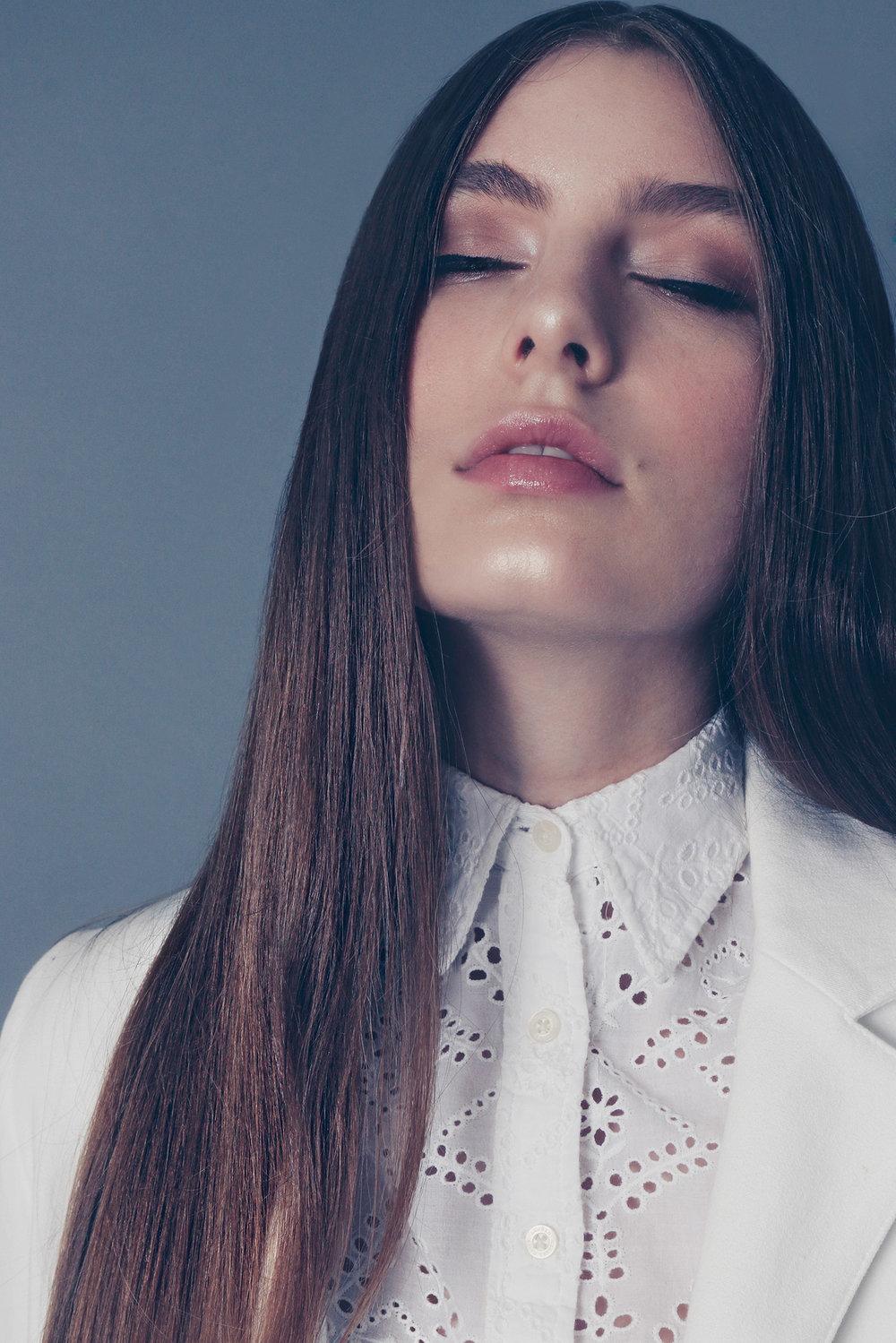amora_beauty_studio_home_woman_fashion_model_indie_white_coat_eyes_closed.jpg