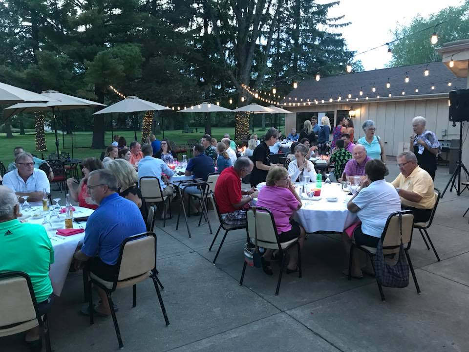 Enjoy a delicious meal and summer evening with friends at the Club.