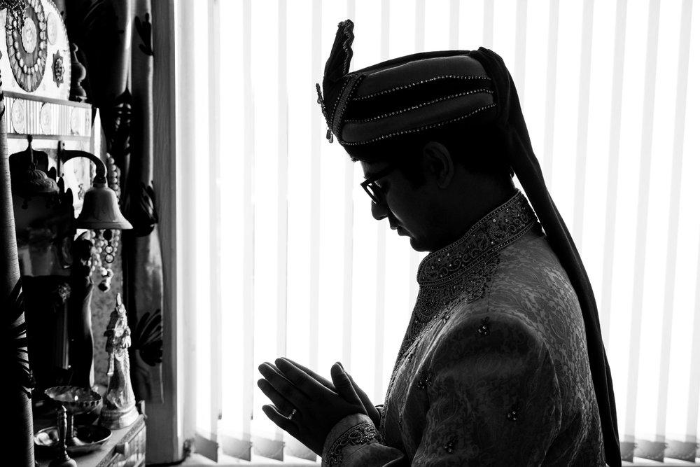 asian-Hindu-wedding-photographer-london-natalia-smith-photography-groom-praying-16.jpg