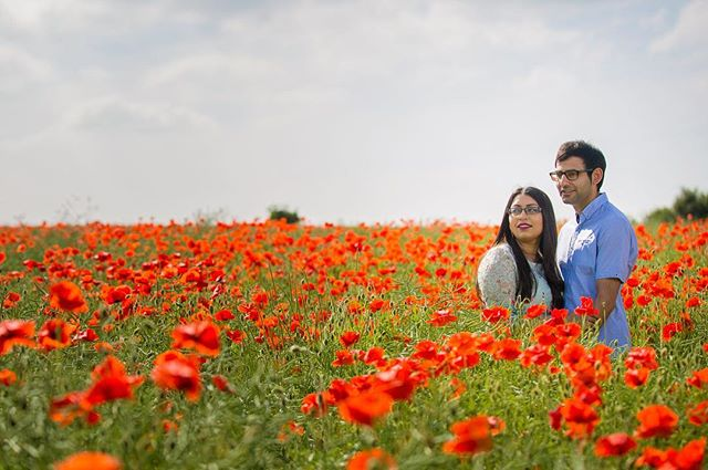 Climbing the fence, getting the feet scratched and legs stung by the nettles - that's all part of an exciting ongoing wedding preparation. Some may disagree, but how often do you end up standing in the middle of the juicy red poppies?! ————————————————————————————- #poppies #poppy #flowers #field #indianwedding #bigfatindianwedding #asianwedding #femaleweddingphotographer #femalephotographer #profoto #photoshoot #photographer #asianweddingphotography #preweddingshoot #engaged #engagementshoot #coupleshoot #couple #wedphotoinspiration #weddinginspiration #ocf