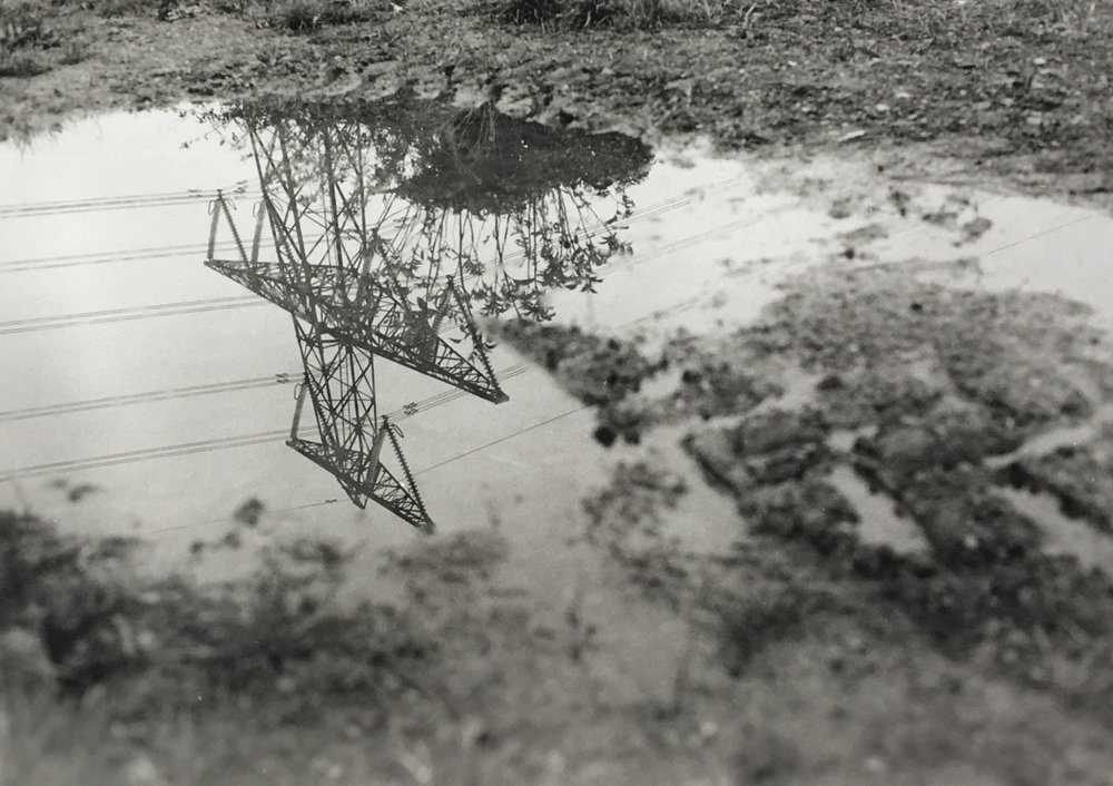 B&W-landscape-environment-human-impact-photography-bath-england-transmission-tower-puddle-mud-reflection-natalia-smith-photography-0004.jpg