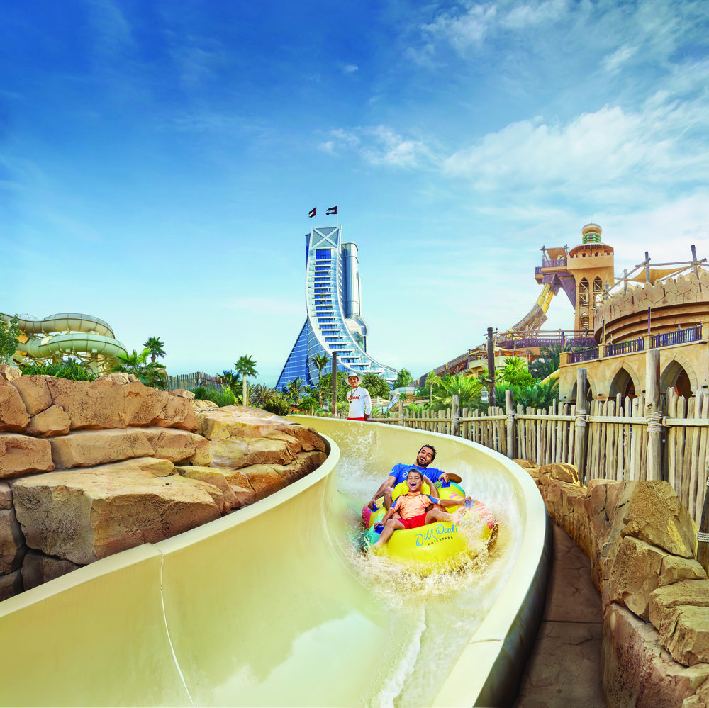 Wild Wadi Waterpark - Father and Son on Wild Wadi Master Blasters with Jumeirah Beach Hotel and Jumeirah Sceirah.jpg