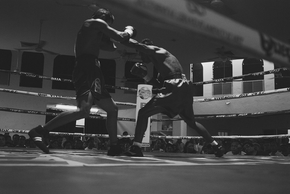 Boxer throws a straight left towards his opponent.