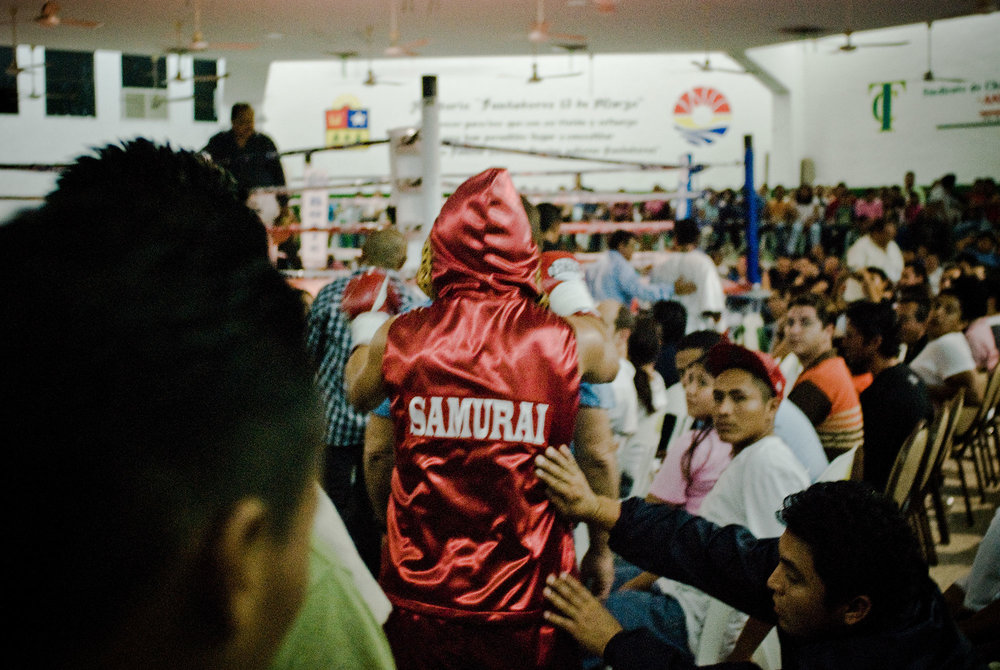 "Boxer ""Samurai"" is being cheered during his walk to the ring."