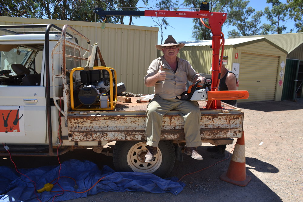 A very happy John Crompton from Arid Recovery with the new crane, generator and chain saw donated by the Rotary Club of Frankston.