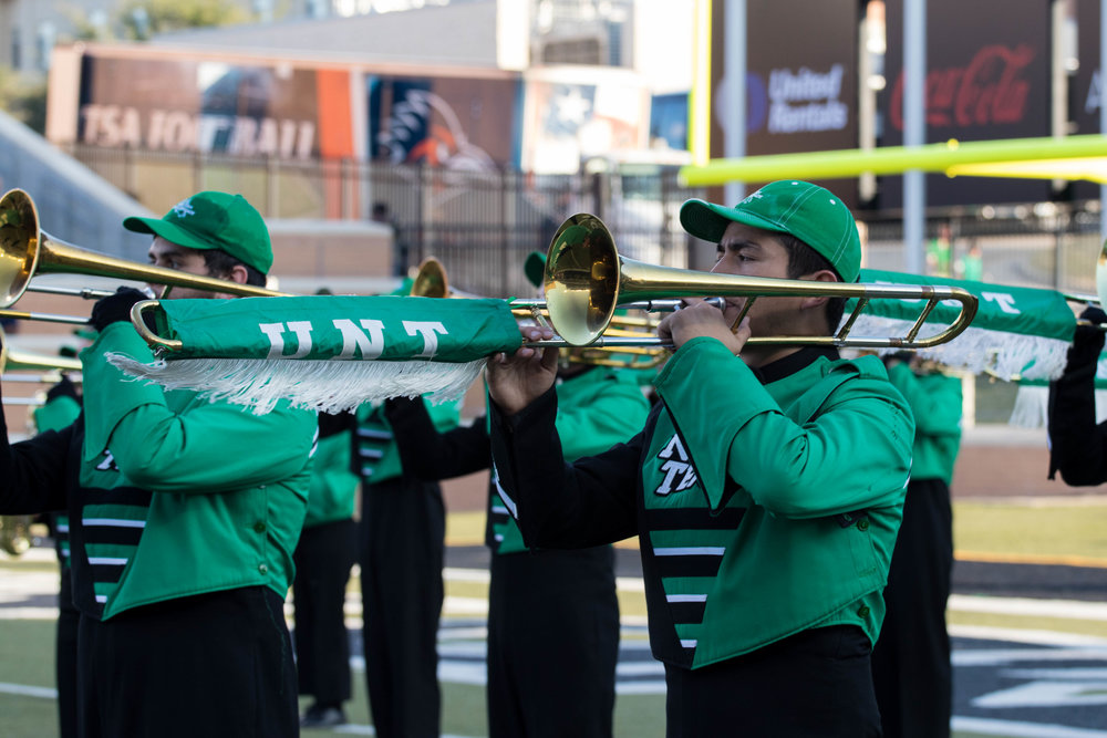 2017 season - As a member of the Green Brigade for three years, I noticed that we did not have our photos taken often. So when my senior year rolled around I knew how I wanted to give back. I attended three of UNT's home games and spent my time with the band roaming the stands and field capturing photos of the 300+ members.