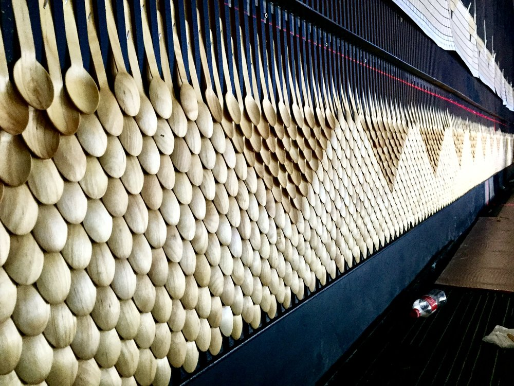 100,00 wooden tea spoons were pinned with pixel perfect precision to the wall either face up or down to create this patterned lighting effect!