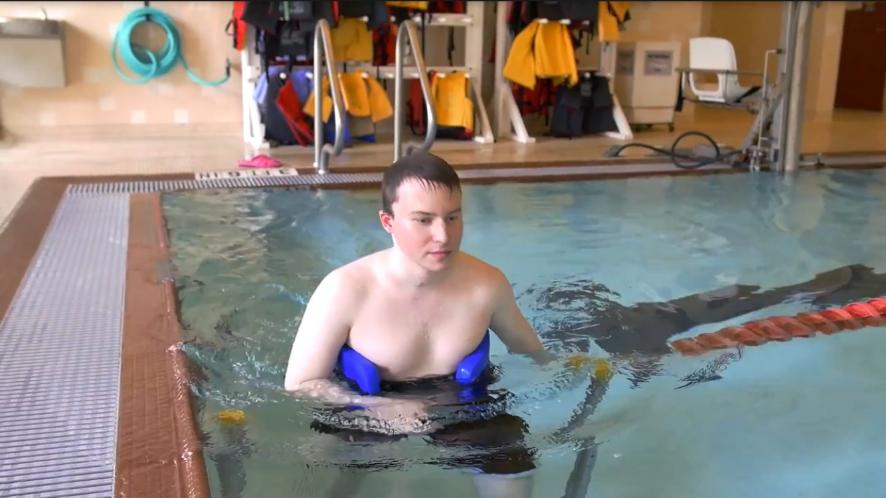 Pool lane gate person with flotation belt
